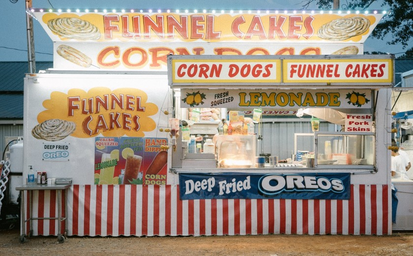 Carnival stand selling unhealthy food choice to illustrate article on self-inflicted diseases and their impact on Health Reform in the United States.